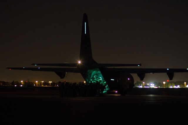 U.S. and South African Soldiers board the C-130J aircraft, from Rhode Island Air National Guard, for a nighttime partnership jump at Bloemspruit Airbase, South Africa, July 23. The jump was in preparation for an exercise that U.S. and South African Soldiers will conduct jointly during Shared Accord 13. Shared Accord is a biennial training exercise which promotes regional relationships, increases capacity, trains U.S. and South African forces, and furthers cross-training and interoperability. The jump will also earn each Soldier a pair of foreign wings for either jumping in a foreign country or jumping with a foreign country's jumpmasters.