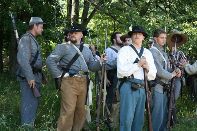 Chief Warrant Officer 2 Jonathan Kantor (in light shirt) takes his position with other re-enactors prior to re-enactment of the Battle of Little Round Top near Gettysburg, Pa., June 29.  The event was part of the sesquicentennial commemoration of the Battle of Gettysburg. (Courtesy photo)