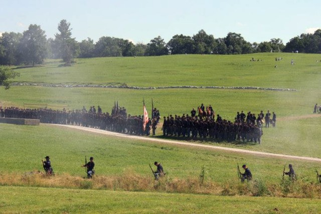 Skirmishers take their positions in front of the main body of a Union regiment during a re-enactment commemorating the Battle of Gettysburg, Pa., which took place 150 years ago in July. (Photo by Chief Warrant Officer 2 Jonathan Kantor, 470th Military Intelligence Brigade)
