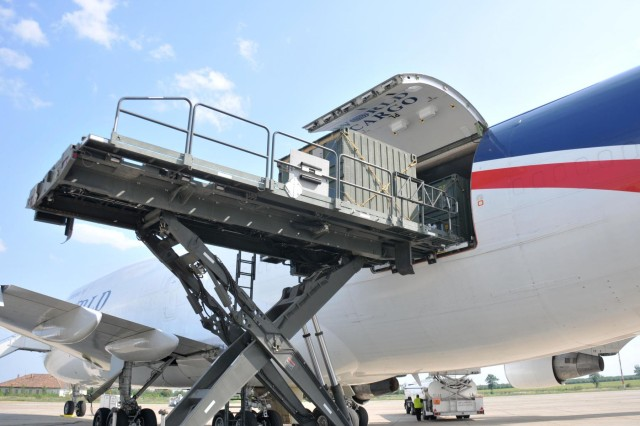 TRICON containers, coordinated by the 21st Theater Sustainment Command's 627th Movement Control Team, are loaded onto a Boeing 747 cargo jet from a cargo lifter in Mihail Kogalniceanu, Romania, July 14, 2013. The 21st TSC, along with the 627th MCT, the 16th Sustainment Brigade and the Air Force's 435th Contingency Response Group moved more than 200 TRICON containers into Afghanistan for the 2nd Cavalry Regiment, taking nine round trips by two B-747s.