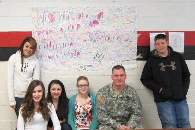 March 5, 2013 at North Buncombe Middle School.  Sgt. 1st Class Jeremy Athy and some students who made banners after his anti-bullying presentation. All the kids in the school signed the banners stating that they will stand up together against bullying.