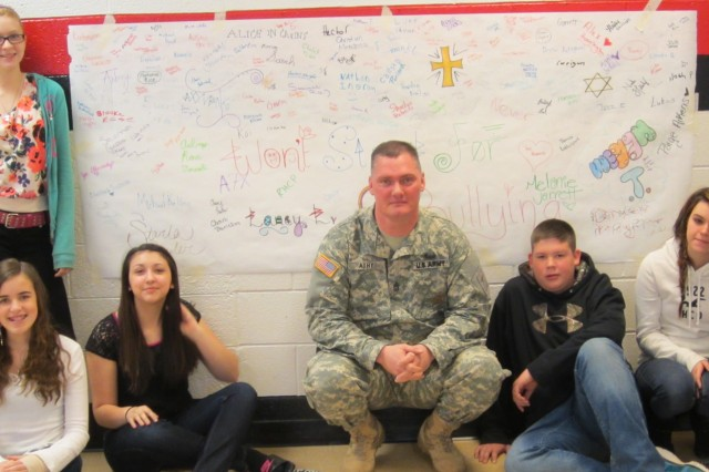 March 5, 2013 at North Buncombe Middle School Sgt. 1st Class Jeremy Athy and some students who made banners after his anti-bullying presentation. All the kids in the school signed the banners stating that they will stand up together against bullying. The students in the picture are: Star Plemmons, Johathan Parker, Megan Treadway, Laney Landeros, and Sarah Myer.