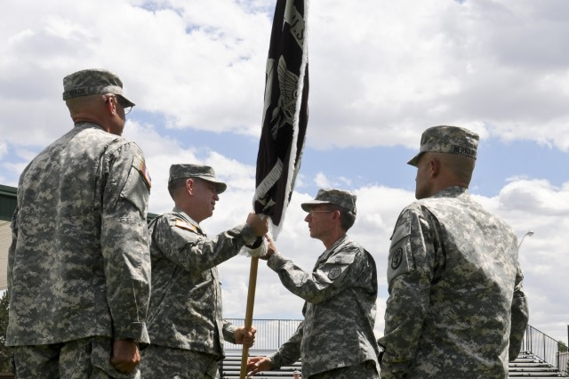 FORT CARSON, Colo. -- Col. George J. Hucal, commander, Western Regional Dental Command, passes the guidon to Col. Michael P. Mahoney, commander, Dental Activity, during a change of command ceremony at Founders Field, July 30, 2013. Mahoney took command of the unit replacing Col. John W. Etzenbach.