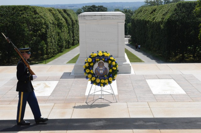 A Tomb Sentinel guards the Tomb of the Unknown Soldier following a wreath laying at Arlington National Cemetery, 26 July, 2013.