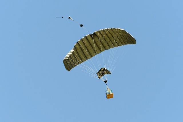 "Cover photo: ""The Joint Precision Air Drop System (JPADS) uses a Global Positioning System (GPS) ""guided cargo parachute enabling U.S. troops to be resupplied by air in a wide variety of terrains, climates and geographically secluded areas. The system's accuracy has recently been greatly increased due to a guidance system software upgrade."""