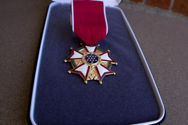 "The Legion of Merit, the first United States decoration created specifically for award to citizens of other nations, was established by an Act of Congress of July 20, 1942, amended by an executive order of March 15, 1955. The reverse of the medal has the motto taken from the Great Seal of the United States ""ANNUIT COEPTIS"" (He [God] Has Favored Our Undertakings) and the date ""MDCCLXXXII"" (1782) which is the date of America's first decoration, the Badge of Military Merit, now known as the Purple Heart. The ribbon design also follows the pattern of the Purple Heart ribbon. Taking into account all service medals soldiers are authorized to wear, per AR 670-1, the Legion of Merit ranks as the ninth highest award, worn after the Defense Superior Service Medal and before the Distinguished Flying Cross."