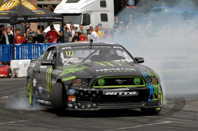 Vaughn Gittin Jr., 2010 Formula Drift champion, puts a Ford Mustang RTR through the paces during a drifting demonstration at a Smoke Show in the parking lot of Lewis Main Post Exchange, Joint Base Lewis-McChord, Wash., July 21.