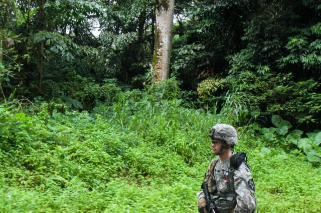 U.S. Army Pfc. Patrick McCoy, a Phoenix, Ariz., native and rifleman with 4th Battalion, 23rd Infantry Regiment, 2nd Brigade, 2nd Infantry Division, walks through the jungle during training in Singapore, July 18, 2013. McCoy is in Singapore supporting Exercise Lightning Strike, a U.S. Army Pacific sponsored platoon-sized event that partners Singaporean and U.S. soldiers.