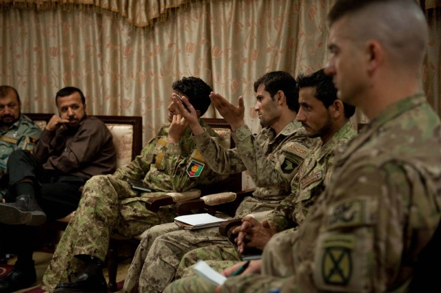 Afghan National Civil Order Police 1st Sgt. Agha (center), intelligence/G2 noncommissioned officer, speaks up during an intelligence briefing at Forward Operating Base Fenty, Nangarhar province, Afghanistan, July 22, 2013. Intelligence personnel from the Afghan Border Police and the U.S. Army were also present. The briefing covered security concerns for Zone 1, which is comprised of the Nangarhar, Nuristan and Kunar provinces in eastern Afghanistan. (U.S. Army photo by Sgt. Margaret Taylor, 129th Mobile Public Affairs Detachment)