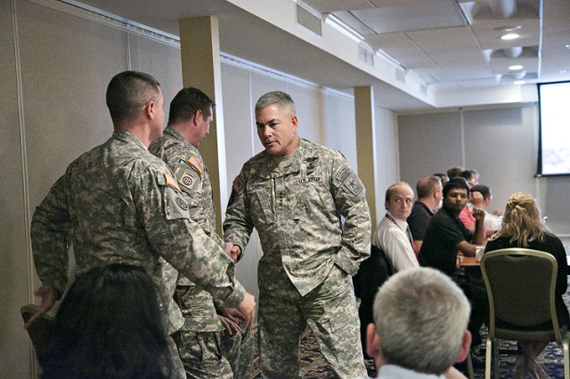 Vice Chief of Staff of the Army, Gen. John F. Campbell greets a Soldier before a focus session with Soldiers and Department of the Army Civilians for the Army's Ready and Resilient Campaign at the Cannon Gates Catering and Conference Center at Picatinny Arsenal.