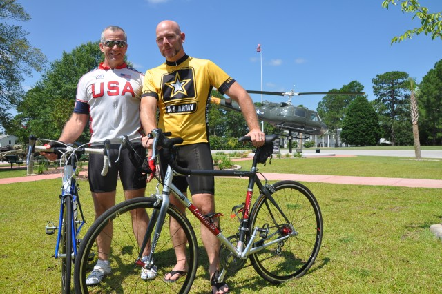 Chuck Cornwell, left, a supervisory staff officer at the National Center for Credibility Assessment, helped student Erik Modisett become an experienced cyclist during his time on post.