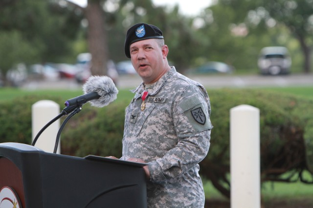 Col. Brian Dunn, former Fires Center of Excellence and Fort Sill chief of staff, thanks numerous people during his retreat ceremony July 26 in front of McNair Hall.