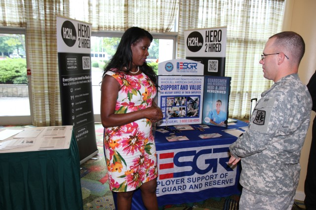 1st Sgt. Robert J. Snyder, 374th Military Police Company, Chambersburg, Penn., visits one of the informational booths at the Army Reserve Family Readiness Education for Deployment event the 200th Military Police Command sponsored in Tampa, Fla., July 26-28. Several agencies sponsored booths and presented information during the event, including ESGR, Heroes for Hire, TRICARE and Tutors.com. (Army Reserve photo by Cpt. William Geddes)