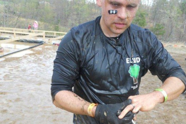 Capt. Rob Behrman, a strategist with the Office of the Chief of Army Reserve, and PhD candidate in engineering and public policy, recovers from the physical challenges presented by the Tough Mudder event.