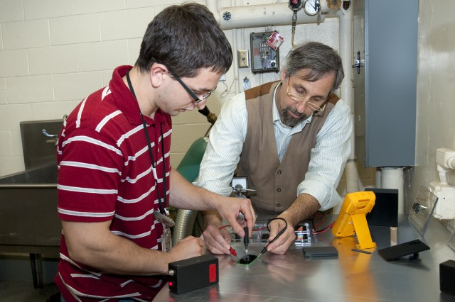 John Russo, who uses 3D printing to fabricate the Long-Lived Power battery casings, works with Marc Litz, Ph.D., both of the Power and Energy Division at U.S. Army Research Laboratory, to measure output voltage on space-grade photovoltaic cells before bonding tritium capsule to a photovoltaic wafer.