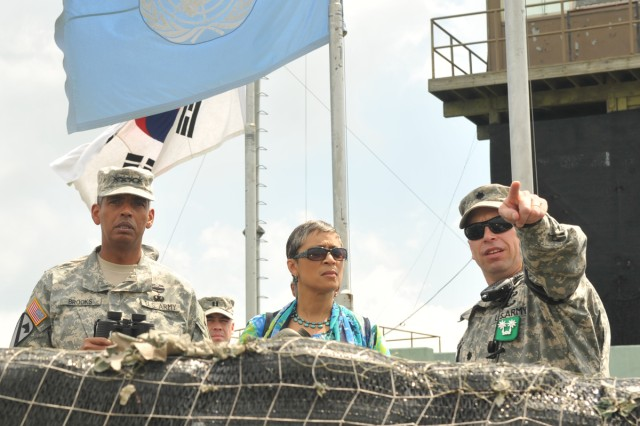 U.S. Army Pacific Commander Gen. Vincent K. Brooks (left), Dr. Carol P. Brooks, and United Nations Command Security Battalion Commander Lt. Col. Daniel Edwan visit Observation Post Ouellette inside the Korean Demilitarized Zone, Aug. 2, 2013.