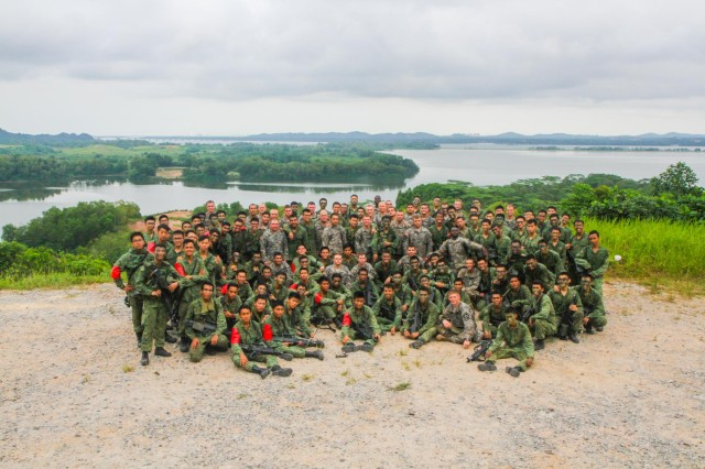 Members of 2nd Battalion, Singapore Infantry Regiment, and U.S. Army Soldiers with 4th Battalion, 23rd Infantry Regiment, 2nd Brigade, 2nd Infantry Division, stand together for a photo after concluding a jungle training exercise in Singapore, July 25, 2013. The training mission was part of Exercise Lightning Strike, a 12-day event sponsored by U.S. Army Pacific.