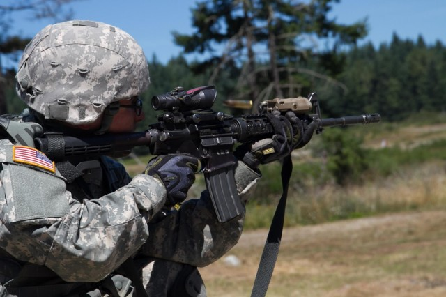Cadet Alexander Henriod, a Reserve Officers' Training Corps (ROTC) student at University of Nevada fires an M4 carbine assault rifle at a qualification range with Soldiers assigned to the 2nd Battalion, 1st Infantry Regiment at Joint Base Lewis-McChord, Wash., July 26, 2013. Henriod was one of eight ROTC cadets, who the 2nd Battalion, 1st Infantry Regiment sponsored for Cadet Leadership Training, a program where cadets shadow junior officers. (U.S. Army photo by Sgt. Memory E. Payne/Released)