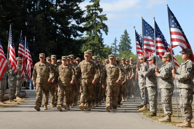 U.S. Soldiers with the 4th Stryker Brigade Combat Team, 2nd Infantry Division march into Soldiers Field House at Joint Base Lewis-McChord, Wash., July 28, 2013. during a welcome home ceremony.  (U.S. Army photo by Pfc. Reese Von Rogatsz/Released)