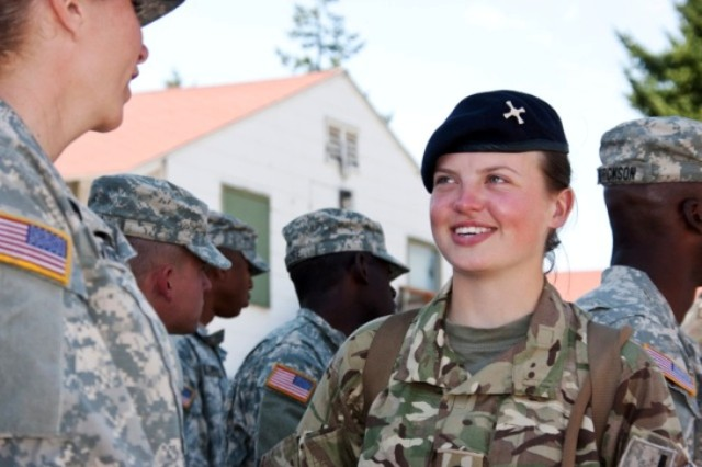 British Army cadet Lottie Hollins (right), from Oxford, U.K. and Newcastle University, talks with an American cadet two days prior to their July 30th graduation ceremony from the Leader Development and Assessment Course at Joint Base Lewis-McChord, Wash.