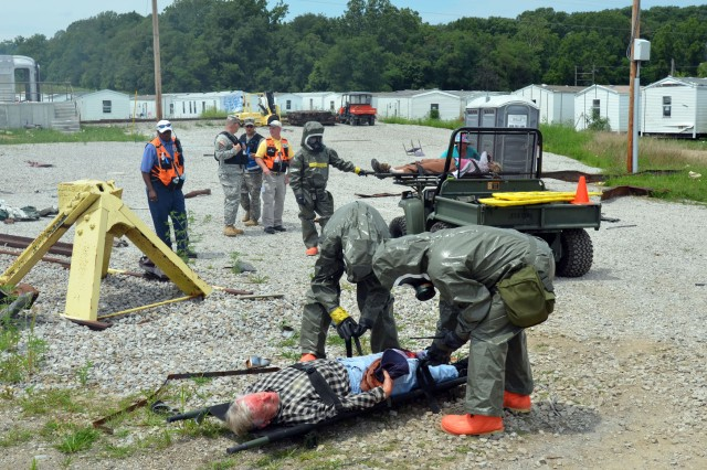 "MUSCATATUCK URBAN TRAINING CENTER, Ind. "" Members of the 300th Chemical Company, a U.S. Army Reserve unit from, Morgantown, W. Va., extract simulated victims Aug. 2 during the Vibrant Response 13-2 exercise. The unit is responsible for searching for and extracting trapped people as well as ensuring the area is safe for first responders and medical personnel. VR13-2 is a major field training exercise conducted by U.S. Northern Command and led by Army North (Fifth Army). Military members and civilians from various federal agencies are in Indiana training to respond in the event of a catastrophic domestic incident."