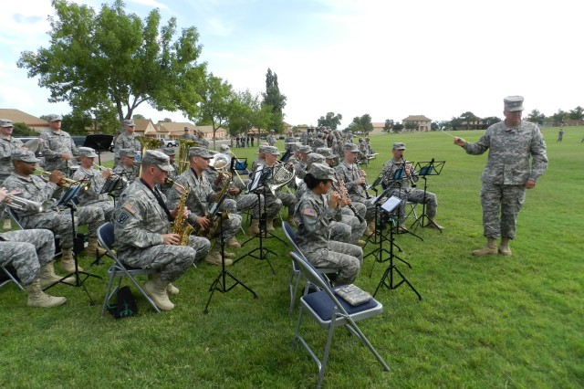 "Under the direction of Chief Warrant Officer 2 George Bauer, the 62nd Army Band performs at the installation retirement ceremony July 26 on Brown Parade Field. Songs included ""Old Soldiers Never Die,"" ""Old Lang Zyne"" and ""The Army Song."""
