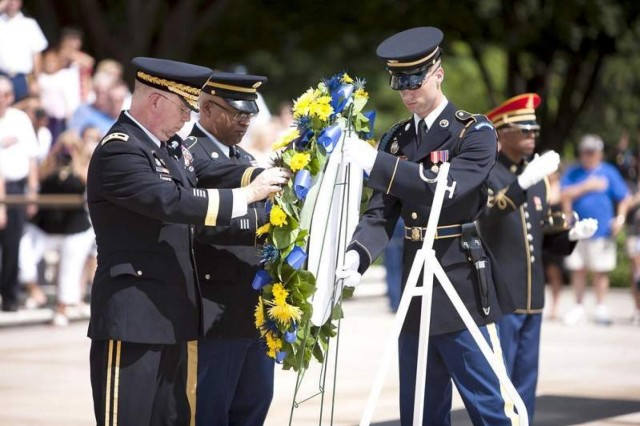 (From the left) Army Chief of Chaplains Chap. (Maj. Gen.) Donald L. Rutherford and Chaplain Corps Regimental Sgt. Maj. Stephen A. Stott lay a wreath at the Tomb of the Unknowns in Arlington National Cemetery July 26.