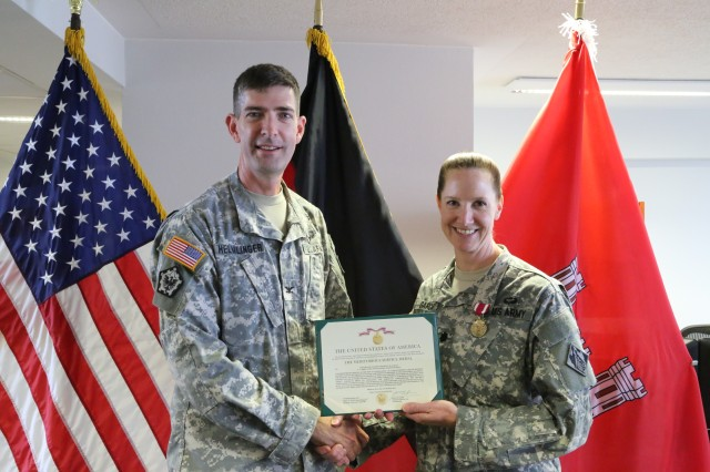 Lt. Col. Michelle Garcia, the U.S. Army Corps of EngineersEurope District deputy commander, is presented the Meritorious Service Medal by Col. Peter Helmlinger, district commander, during an award ceremony July 17 at the Amelia Earhart Center in Wiesbaden, Germany. Garcia, who joined the district in July 2011, is headed to Fort Leavenworth, Kan., where she'll serve as a leadership instructor in the Combined Arms Center.