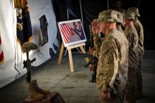 U.S. Soldiers with Cross Functional Team Warrior pay respect to Sgt. Anthony R. Maddox, Foxtrot Company, Cross Functional Team Summit, during a fallen hero ceremony held in Afghanistan, July 27, 2013. (U.S. Army photo by Sgt. 1st Class Kenneth Foss/Released)