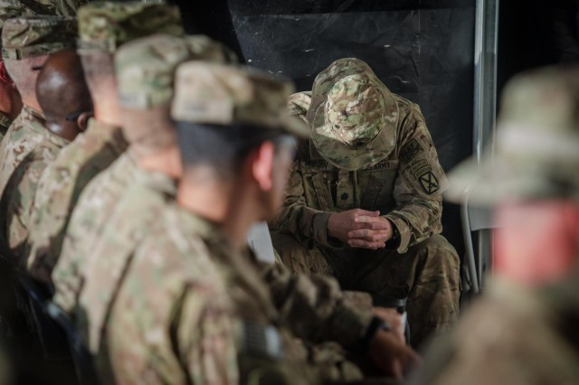 U.S. Army Lt. Col. Daniel S. Morgan, Cross Functional Team Summit commander, lowers his head with overwhelming emotion after finishing his speech, during a fallen hero ceremony in Afghanistan, July 27, 2013. (U.S. Army photo by Sgt. 1st Class Kenneth Foss/Released)
