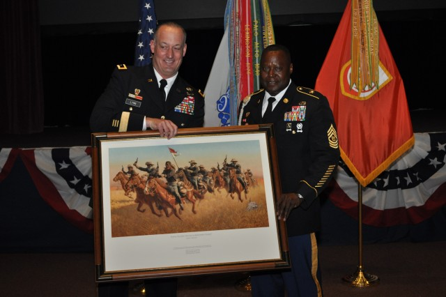 Maj. Gen. Alan R. Lynn, NETCOM commanding general, presents Command Sgt. Major Gerald W. Williams, the former NETCOM command sergeant major, a framed Buffalo Soldier lithograph during Williams' retirement ceremony Aug. 1.  Williams is retiring after 28 years of service in the Army.