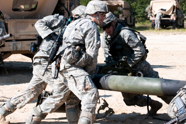 Spc. Ryan J. Caouette, an airborne artilleryman with the 82nd Airborne Division's 1st Brigade Combat Team, and fellow paratroopers emplace a M119A3 105 mm lightweight howitzer, July 30, at Fort Bragg, N.C., during gun crew certifications. Many of the activities paratroopers in the 82nd Airborne Division's 1st Brigade Combat Team participate in from the time they show up for physical training to the end of the duty day are focused on building troopers who are ready to win the current fight and the next, and who are resilient throughout whatever challenges may come. (U.S. Army photo by Staff Sgt. Mary S. Katzenberger)