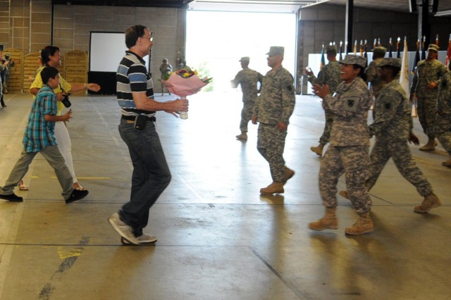 Soldiers from the 21st Theater Sustainment Command's 1st Human Resources Sustainment Center run to their families after being released during a redeployment ceremony at Rhine Ordnance Barracks, Aug. 5.