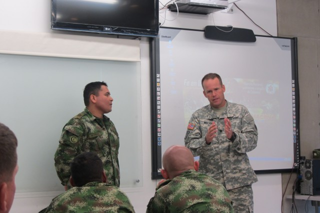 Lt. Col. Jerrod W. Killian, chief, clinical operations, command veterinarian for U.S. Army South, conducts a class with Colombian army veterinarians. Killian was part of an Army South delegation of Soldiers and civilians that traveled to Bogota, Colombia, to discuss the care, prevention and treatment of diseases military working dogs are diagnosed with while conducting operations.