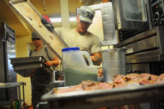 U.S. Army Spc. Gregory Fulton, a cook with the 368th Engineer Battalion, prepares a meal for Soldiers participating in Operation River Assault at Fort Chaffee, Ark., July 17, 2013.