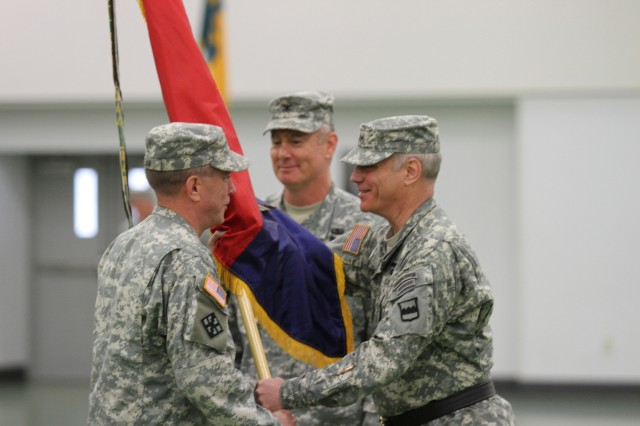 Col. John Elam, incoming commander of the 102nd Training Division (MS) receives the colors from Maj. Gen. Bill Gerety, commander, 80th Training Division (TASS), during a change of command ceremony held at Fort Leonard Wood, Mo., August 4, 2013.