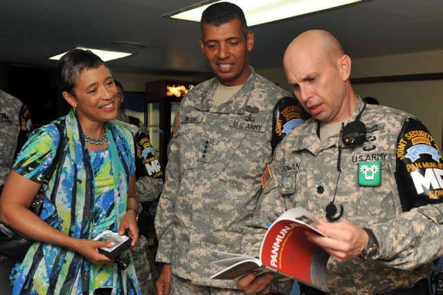 (From the left) Dr. Carol Brooks, U.S. Army Pacific Commander Gen. Vincent Brooks and United Nations Command Security Battalion Commander Lt. Col. Daniel Edwan talk at the Sanctuary Club on Camp Bonifas, South Korea, Aug. 3, 2013.