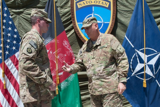 Army Chief of Staff Gen. Raymond T. Odierno presents International Joint Command Soldiers with his coin in Kabul, Afghanistan, Aug. 6, 2013. Odierno met with U.S. troops and leadership during his trip to Afghanistan.