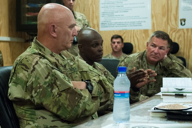 Army Chief of Staff Gen. Raymond T. Odierno receives a briefing from Maj. Gen. James C. McConville, 101st Airborne Division (Air Assault) commanding general (right), Brig. Gen. Ronald F. Lewis, 101st Airborne Division (Air Assualt) deputy commanding general (middle), in Gamberi, Afghanistan, Aug. 6, 2013. Odierno met with U.S. troops and leadership during his trip to Afghanistan.