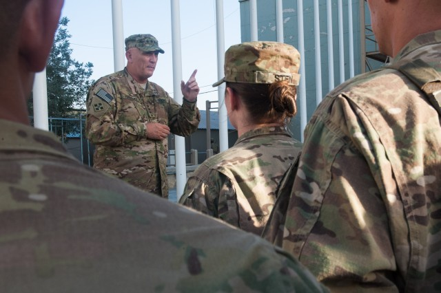 Soldiers listen to U.S. Army Chief of Staff Gen. Raymond T. Odierno speak outside of Regional Command-East Headquarters at Bagram Airfield, Afghanistan, Aug. 6, 2013. Odierno met with U.S. troops and leadership during his trip to Afghanistan.