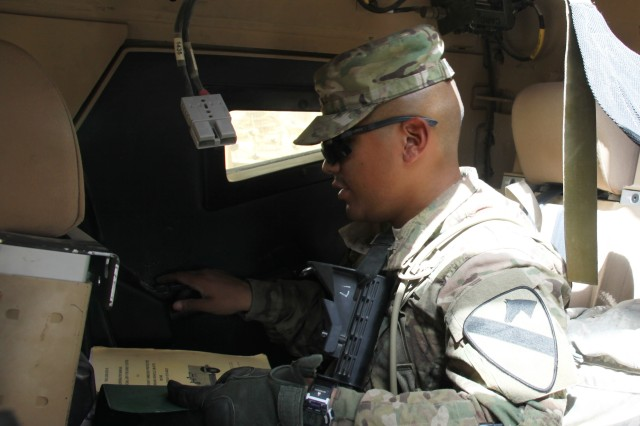 Pvt. David Delgado conducts maintenance checks to ensure that the unit's MaxxPro Mine Resistant Ambush Protected armored fighting vehicle is fully mission capable. Delgado is assigned to 2nd Brigade Combat Team, 1st Cavalry Division, the last unit scheduled to receive equipment from the 401st AFSBn-Kandahar in preparation for the reduction of U.S. military presence and full transition to Afghan security lead by December 2014. (Photo by Sharonda Pearson, 401st AFSB Public Affairs)