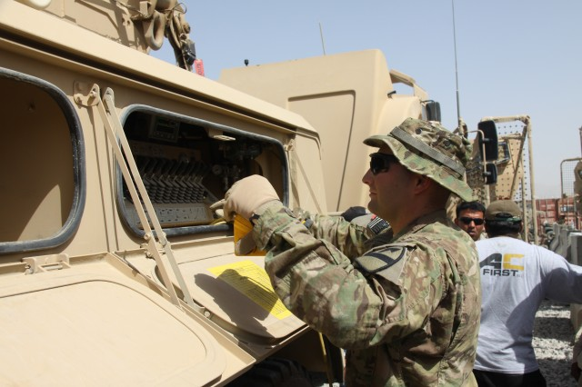 Soldiers assigned to Company B, 2nd Brigade Combat Team, 1st Cavalry Division check equipment prior to signing for accountability. (Photo by Sharonda Pearson, 401st AFSB Public Affairs)