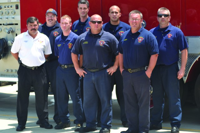 Pine Bluff Arsenal firefighters, including Fire Chief Jackie Doherty, Firefighter Harrington, Lt Wade, Capt. West, Lt. Kimzey, Capt. Weiss, Lt. Rodriguez and Lt. Beers, pose in front of the ladder truck at the fire station. The Arsenal's Fire and Emergency Services Division was named the U.S. Army Material Command Small Fire Department of the Year for 2012.