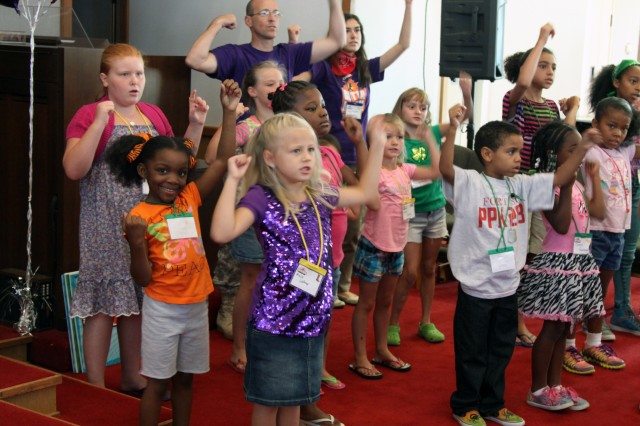 "Children dance during Fort Sill's Vacation Bible School at Frontier Chapel. The theme of the week was ""Gotta Move! Keepin' in step with the Spirit."" The program designed for children in kindergarten through fifth grade happened July 29 through Aug. 2."