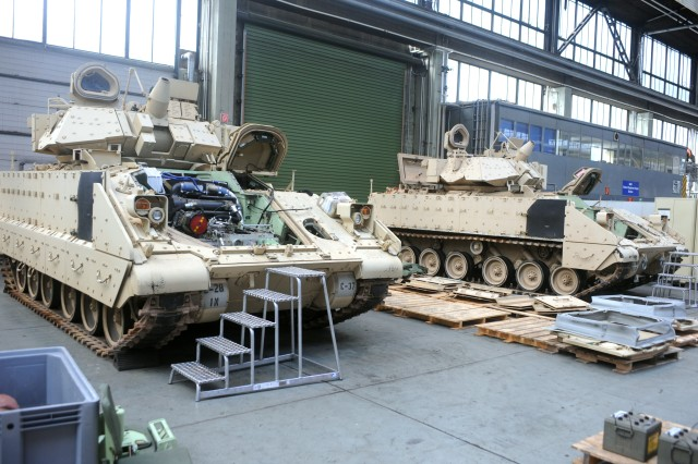 Two Bradley Infantry Fighting Vehicles await the re-assembly process after being deconstructed and cleaned in preparation for transport back to the U.S. at Kaiserslautern Army Depot, Germany, July 30, 2013. The 21st Theater Sustainment Command's Theater Logistics Support Center-Europe and Maintenance Activity Kaiserslautern are responsible for retrograding a total of 88 Bradleys.