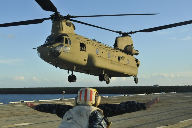 A CH-47 Chinook with 3rd Battalion, 25th Aviation Regiment, 25th Combat Aviation Brigade, 25th Infantry Division, lands on the USS Tarawa (LHA-1), a U.S. Navy amphibious assault ship, during deck qualification in the Pacific Ocean, July 19, 2013.