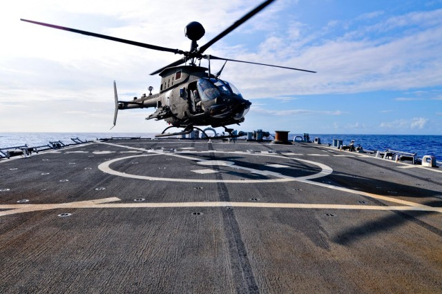 A U.S. Army OH-58D Kiowa Warrior helicopter assigned to 2nd Squadron, 6th Cavalry Regiment, 25th Combat Aviation Brigade, 25th Infantry Division, lands on the deck of the USS Hopper (DDG 70), a U.S. Navy destroyer, during deck qualification in the Pacific Ocean, July 15, 2013.