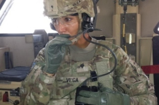 Specialist Nancy Vega, truck driver, Echo Company, 2nd Battalion, 2nd Infantry Regiment, 3rd Infantry Brigade Combat Team, conducts a radio check prior to a mission brief at Forward Operating Base Apache Aug. 7, 2013. Vega serves in support of Operation Enduring Freedom working with a platoon responsible for vehicle recovery.