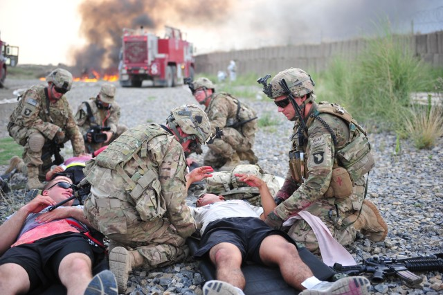 Soldiers from 2nd platoon, Whiskey Company, 2nd Battalion, 506th Infantry Regiment, attached to the 4th Brigade Special Troops Battalion, attend to simulated casualties at the casualty collection point during a mass casualty exercise on Forward Operating Base Salerno, Afghanistan, Aug. 6, 2013.