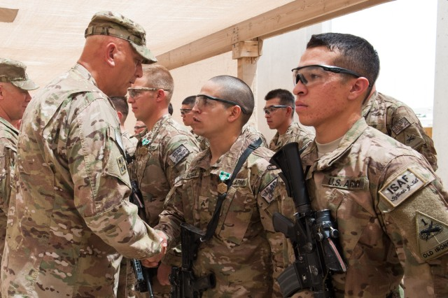 "Army Chief of Staff Gen. Raymond T. Odierno presents Cpl. Kevin Bonilla, with 1st Brigade, 1st Armored Division, with the Army Commendation Medal with the ""V"" device, on Forward Operating Base Azizullah, Afghanistan, Aug. 7, 2013. Odierno thanked Soldiers for their dedication to the Army and service to their country during his trip to Afghanistan."